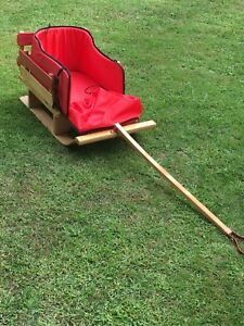 Wooden baby sleigh with padding