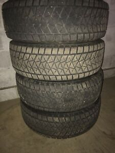 Four Bridgestone blizzak winter tires with rims 245/60R18.