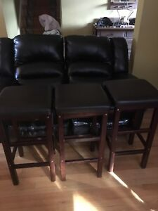 3 brown bar stools