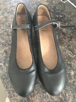 Bloch dance shoes with heel.