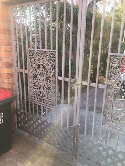 Twin metal gates. Exactly Garage door size