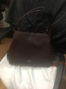Coach ox-blood leather purse.  Brand new