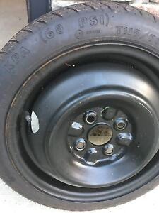 Corolla spare tire and manual Jack