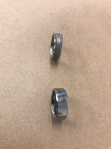 Tungsten steel rings payed $600 for both no longer need