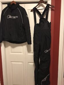 Worn Once! Size 8 ladies FXR snowmobile suit with gloves, helmet