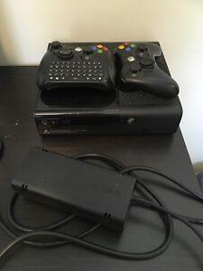 Xbox 360 E console + games + controllers