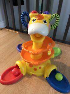 Giraffe fisher price 15$