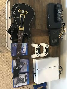 PlayStation 4 with guitar hero, games and controllers