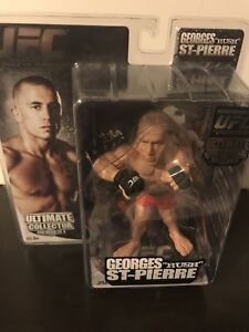 UFC George St. Pierre figure and 2 DVD sets