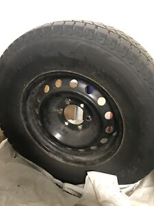 Brand new winter tires and rim 265 70 R17