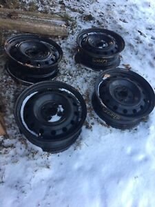 4 steel rims with all season tires