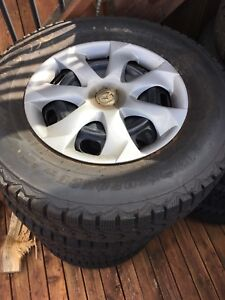 Set of 4 235/70/R16 Firestone winter tires with rims