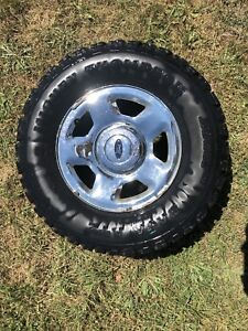 """2005 Ford F-150 17"""" steel rims and mickey thompson tires"""