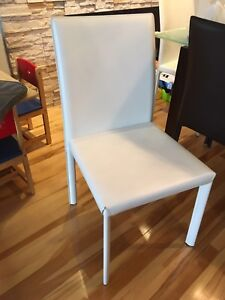 2 white leatherette dining chairs