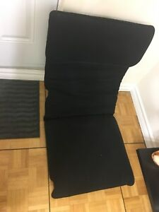 Supportive black cushion for chair