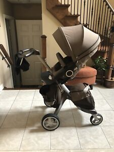 Used Stokke Xplory in brown- Includes a matching Stokke BABY BAG