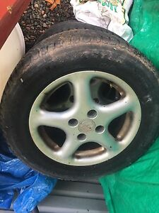 """4x100 14"""" volkswagon alloys with winter tires"""