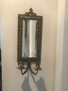 A pair of antique French bronze sconces