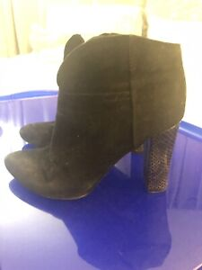 Nine West women's black suede booties with snakeskin heel