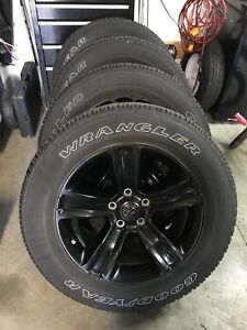 """20"""" black rims and tires from 2017 Dodge Ram 1500 Sport"""