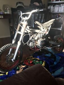 Gio dirt bike 125cc/800 o.b.o has gas tank