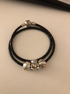 Pandora leather bracelet and two tone charms