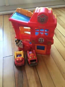 Fisher price fire house + cars