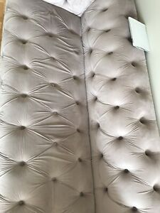 Tufted sofa in taupe