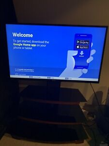 """Toshiba 50"""" 4K TV with Entertainment Unit Stand"""