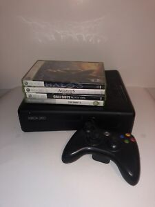Xbox 360 Slim with 4 games