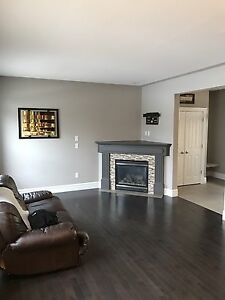 Beautiful walkout home backing onto trails - Available Now