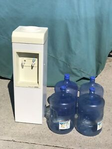 Water cooler and 4 jugs