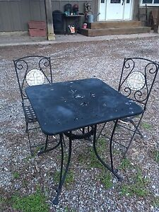 Metal table and mosaic chairs