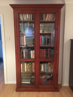 Beautiful 3 year old wooden bookcase with glass doors and lock.