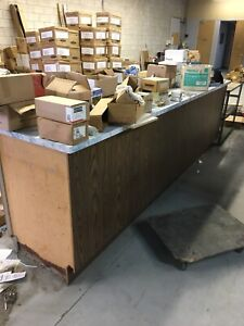 Solid wood cabinet with counter top great for shop!