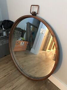 Brass coloured mirror for sale.