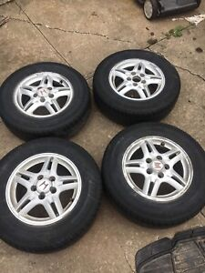 4 honda rims with tires
