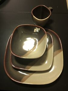 Pfaltzgraff 10 place setting dinner set.