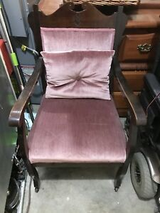 Antique chair (pink) has wheels on feet (4)