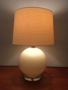 Pair of mid century modern ceramic sphere and Lucite lamps