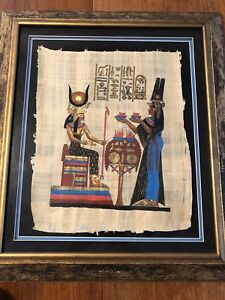 Egyptology collection-books and framed print on papyrus.