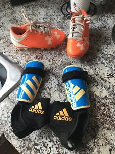 Toddler/Boys size 9 Cleats and shinpads