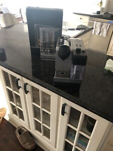 Nespresso coffee machine with milk frothing unit
