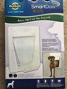 Large electronic automatic dog door **brand new**