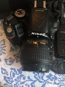 Nikon d5200 with lenses (35 mm) and carrying bag