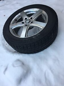 4 Bridgestone blizzak winter tires on  rims  235 55 17   5X120