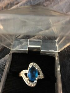 Sterling Silver with Blue Topaz.