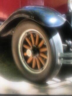 1929 ? Chevrolet timber wheels. Green pair .