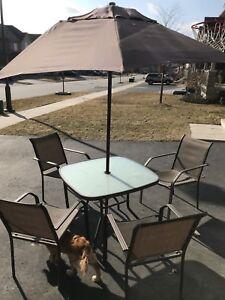 Patio table, chairs & umbrella