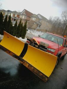 Pickup truck with snowplow and salter